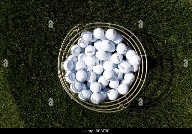 A bucket of golf balls - Stock Image