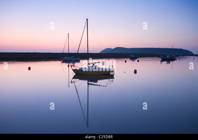 Boats Moored on the River Axe Estuary with Brean Down in the distance. Somerset. England. UK. - Stock Image