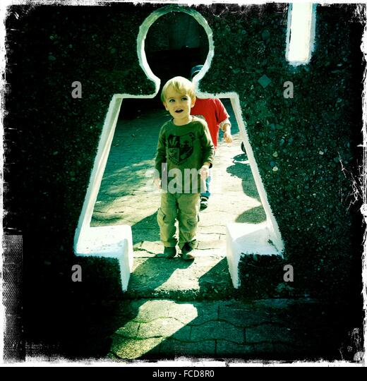 Full Length Of Boy Creative Wall Entrance - Stock Image