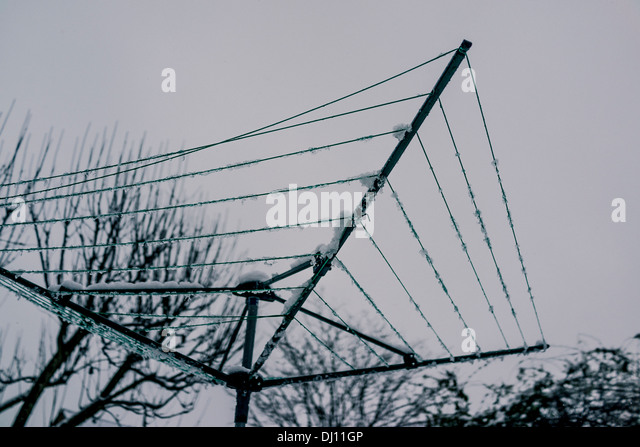 Whirly gig washing line with snow - Stock Image