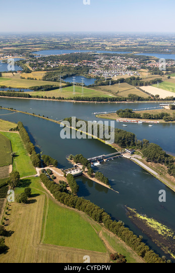 The Netherlands, Maasbracht, Weir in river Maas or Meuse. Aerial. - Stock Image