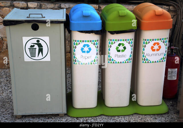 Vouliagmeni Attica Greece Lake Vouliagmeni Normal Bin and Recycling Bins Paper, Plastic and Aluminium and Fire Extinguisher - Stock Image