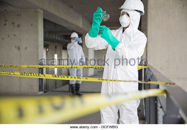 Technicians sampling contaminated water - Stock Image