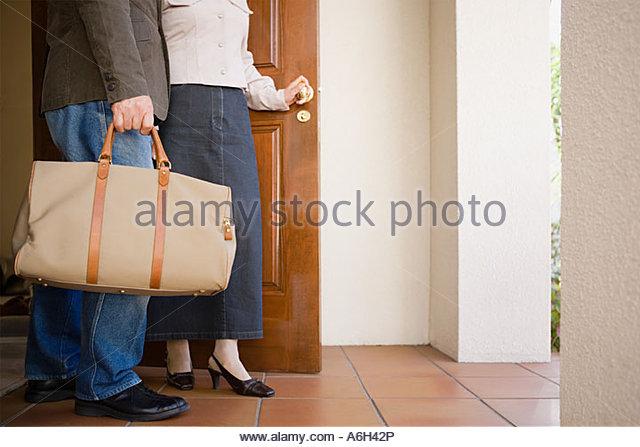 Couple leaving house - Stock-Bilder