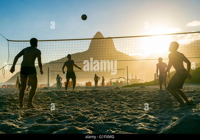 RIO DE JANEIRO - MARCH 27, 2016: Brazilians play futevôlei (footvolley, a sport combining football/soccer and - Stock Image