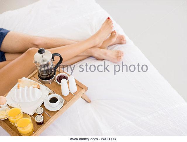 Couple having breakfast in bed - Stock-Bilder