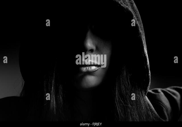 Close-Up Of Woman Wearing Hooded Shirt Indoors - Stock Image