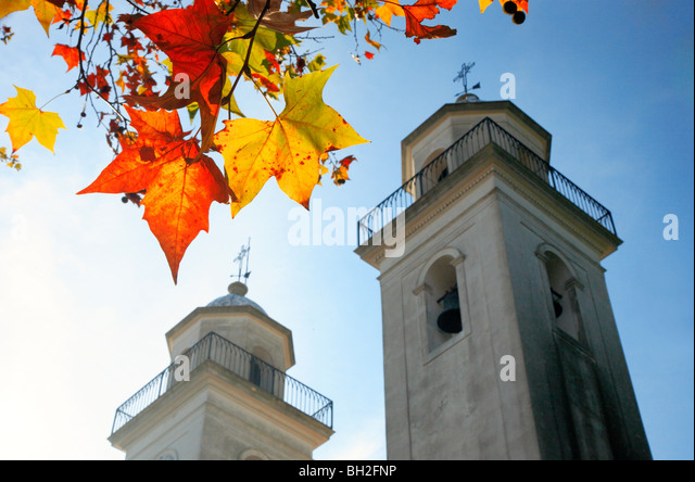 Colonia del sacramento basilica, with maple trees leaves at fall. Uruguay, south america. - Stock Image