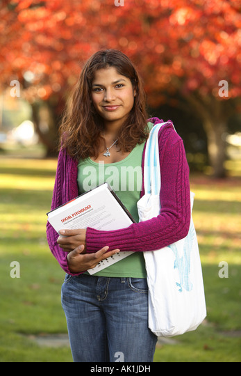 College student portrait with fall campus - Stock Image