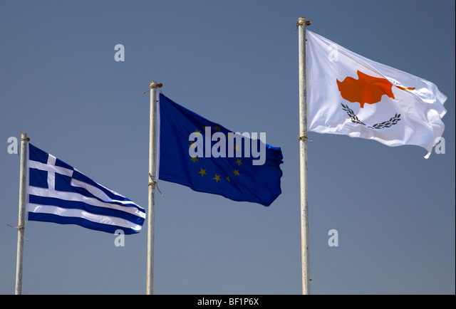 greek republic of cyprus and eu flags flying in a blue sky in cyprus - Stock Image