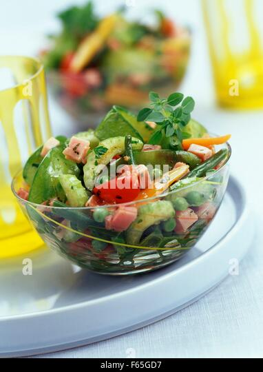Spring vegetables with diced ham - Stock Image