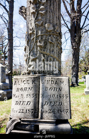 Marquette Michigan Upper Peninsula U.P. UP Lake Superior Park Cemetery early spring grave headstone tombstone death - Stock Image