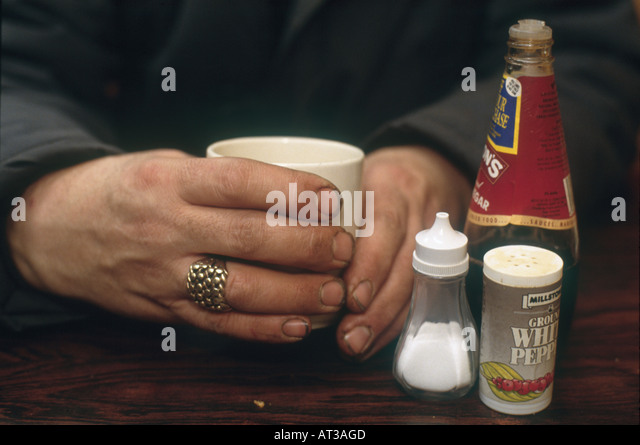 hand on a warm cup of tea at New Covent Garden Market is the largest wholesale market in the country - Stock Image