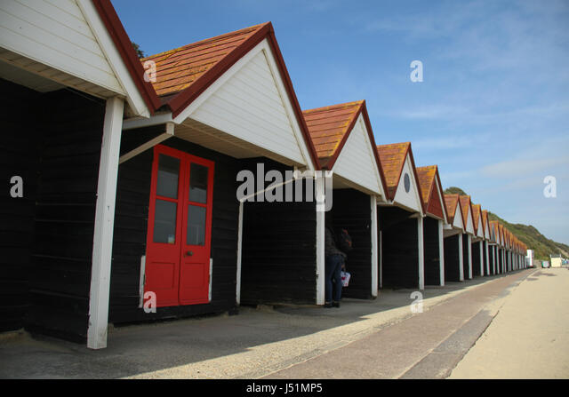 Bournemouth, UK -  11 May: An array of beach huts located in Bournemouth beach. General view of the seaside town - Stock Image