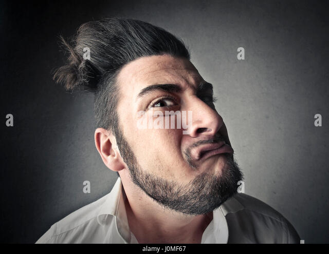 Mad man making grimace - Stock Image
