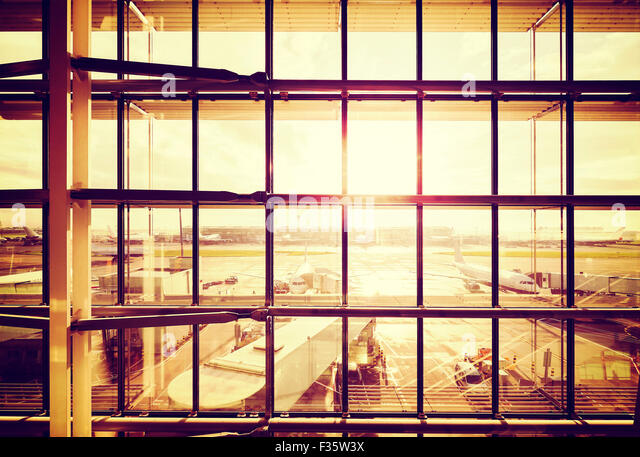 Vintage filtered picture of an airport, transportation and business travel concept. - Stock-Bilder