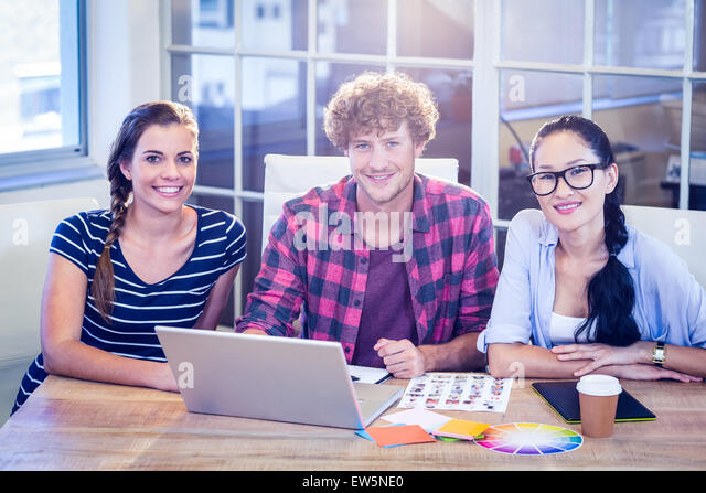 Happy designers smiling at camera - Stock Image
