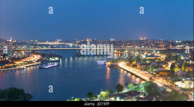 Istanbul city view from Pierre Loti Teleferik station overlooking Golden Horn with Halic Bridge, Golden Horn Metro - Stock Image