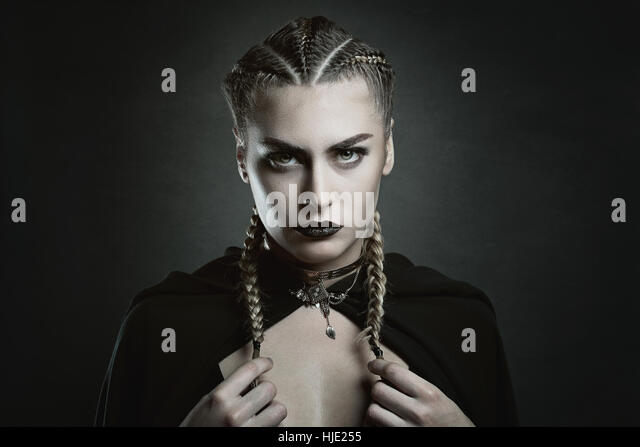 Fashion portrait of a vampire woman . Halloween and horror - Stock-Bilder