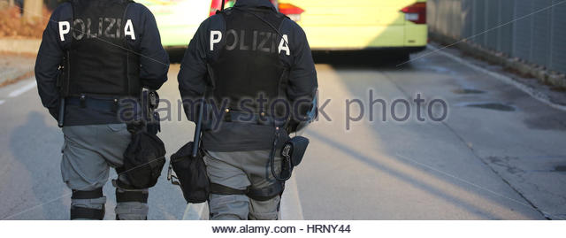 two Italian cops with the words POLIZIA that means POLICE in Italian to clash the hooligans at the stadium football - Stock Image