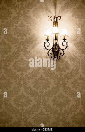 Stylish lamp on the wallpaper - Stock Image