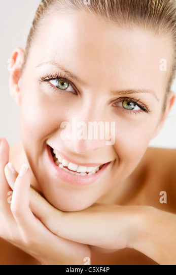 smiling female - Stock Image