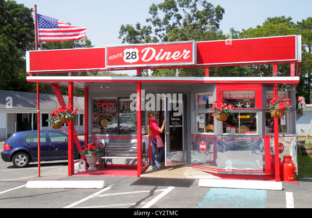 Massachusetts Cape Cod South Yarmouth Route 28 Diner restaurant Americana front entrance waitress woman - Stock Image