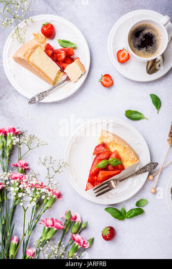 Flat lay with strawberry cheesecake - Stock Image