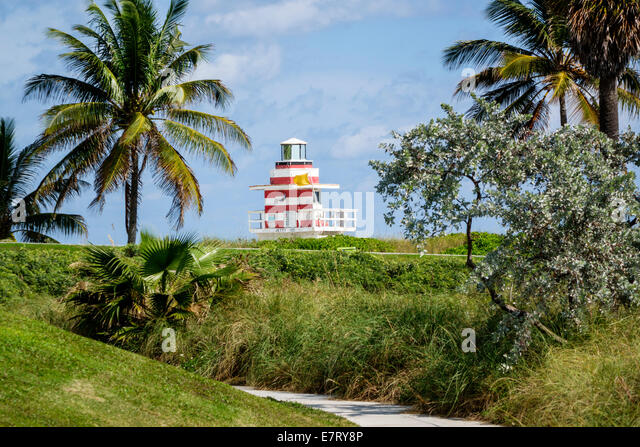Miami Beach Florida South Pointe Park lifeguard station mock lighthouse Atlantic Ocean shore palm tree - Stock Image