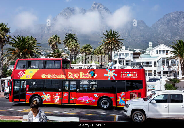 South Africa African Cape Town Camps Bay Victoria Road Table Mountain National Park City Sightseeing red double - Stock Image