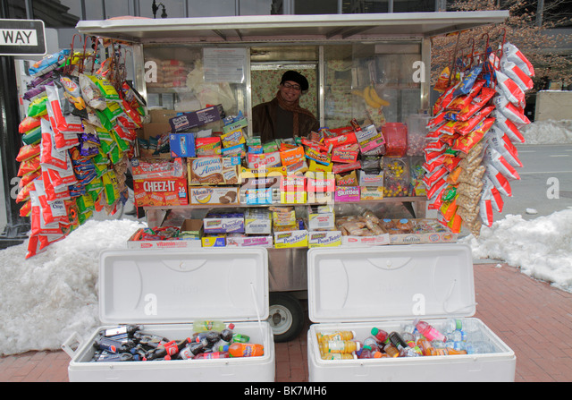 Washington DC Gallery Place street vendor cart business snack food soft drink soda cooler can package chips candy - Stock Image