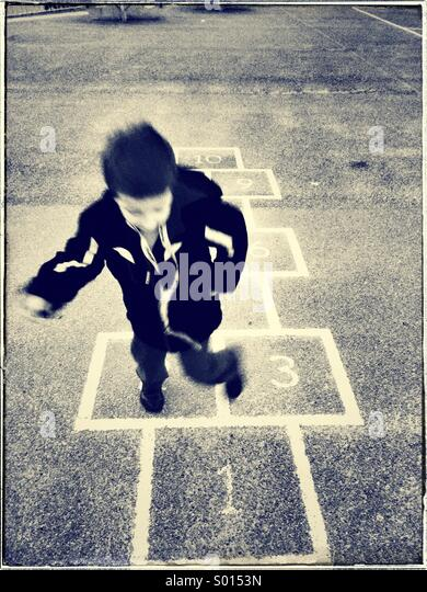 Child playing hopscotch - Stock-Bilder