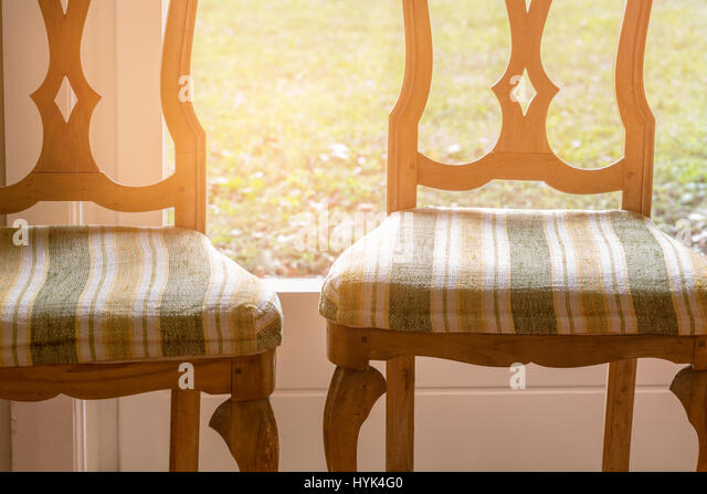 Two old wooden chairs in a house - Stock Image