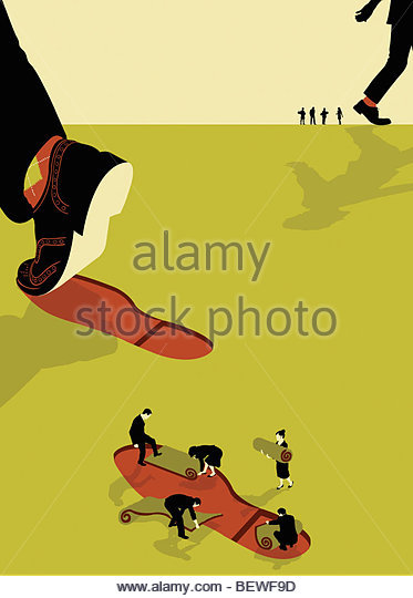 Businesspeople repairing carbon footprint - Stock Image