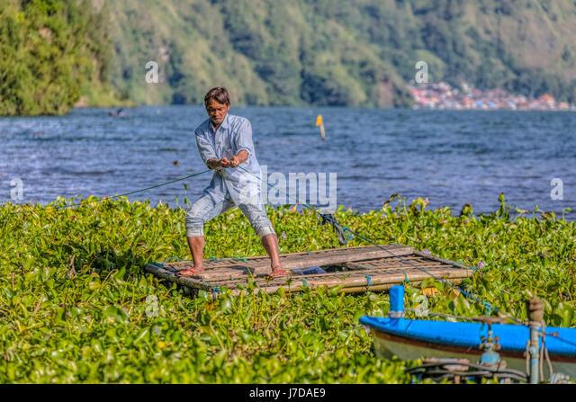fisherman on a wooden raft in Danau Batur, Bali, Indonesia, Asia - Stock-Bilder