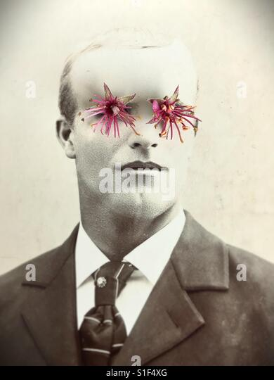 Antique photo of man with surreal flower eyes. - Stock Image