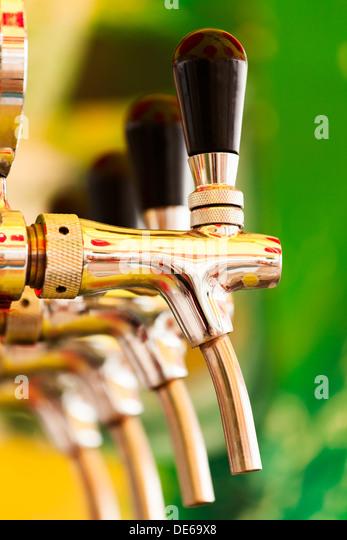 tap beer crane closeup colorful - Stock Image