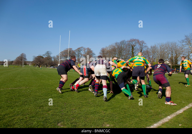 England, West Sussex, Shoreham-by-Sea, Rugby Teams playing on Victoria Park playing fields. - Stock Image