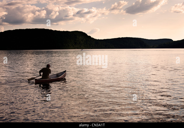 Canoeing on lake, Ontario, Canada - Stock Image