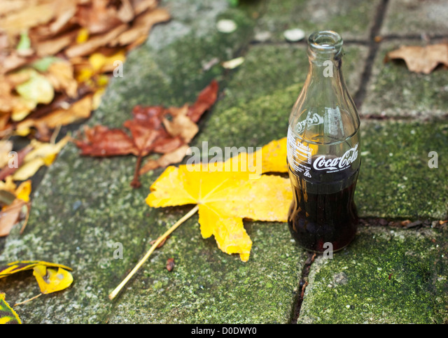 Half full Coca-Cola bottle. - Stock Image
