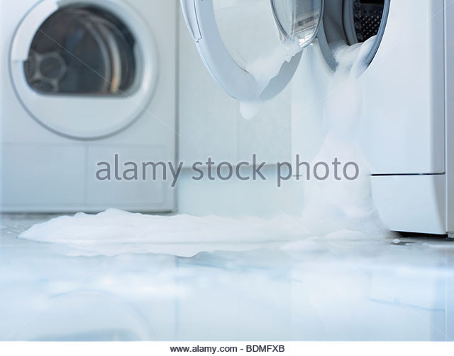 Washing machine overflowing - Stock Image