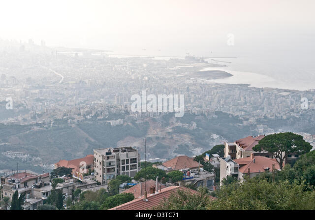 A view of the Lebanese city and port district of Beirut as seen from the town of Beit Meri in the mountains above. - Stock Image