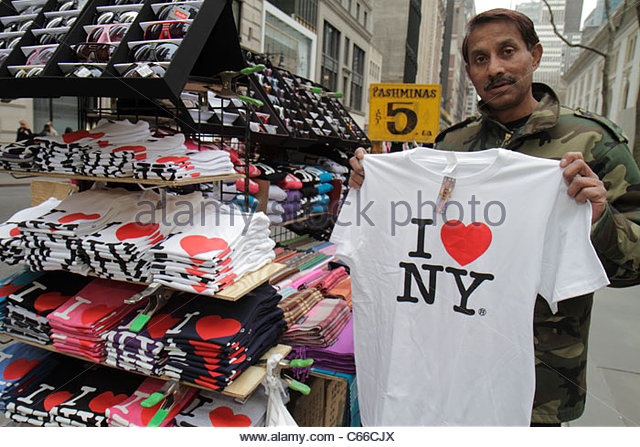 Manhattan New York City NYC NY Midtown 40th Street street vendor souvenir tee t-shirt eyeglasses pashminas Asian - Stock Image