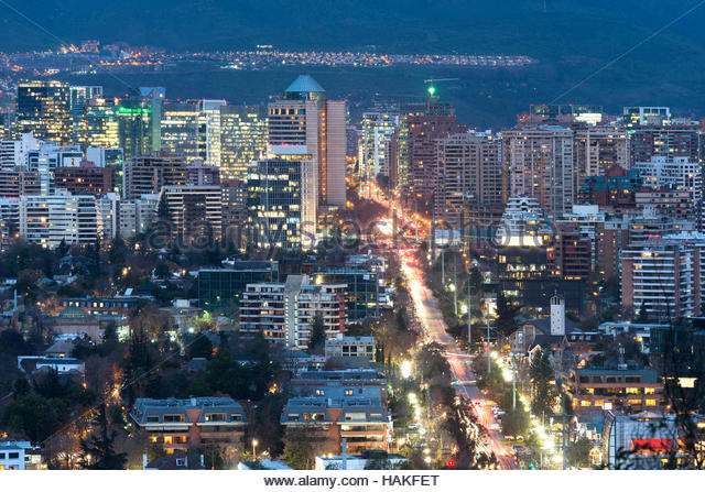 View of residential and office buildings at night in the wealthy district of Las Condes in Santiago de Chile - Stock Image