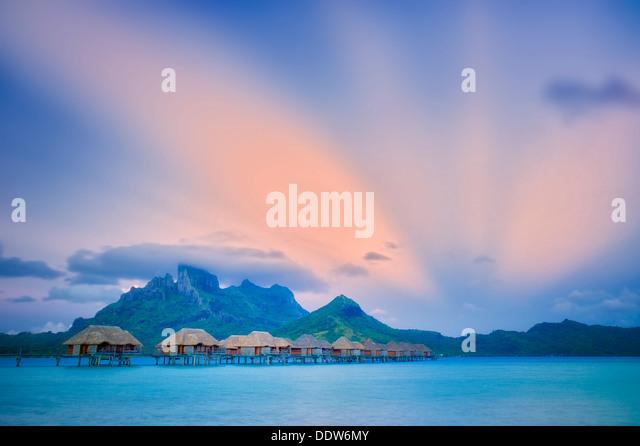 Sunrise and bungalows. Bora Bora. French Polynesia. - Stock Image