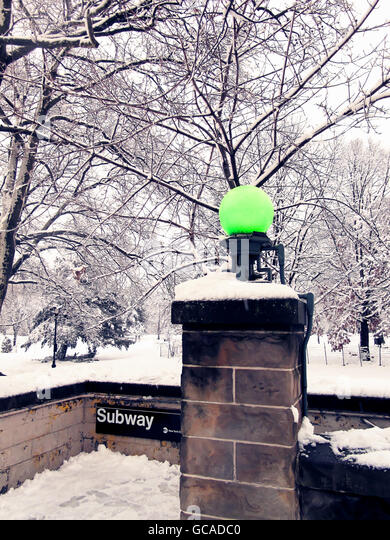 Scenic view of subway entrance by the park in the Winter. - Stock Image