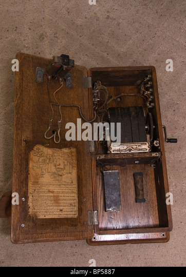 Old wooden wall telephone  inside. - Stock Image
