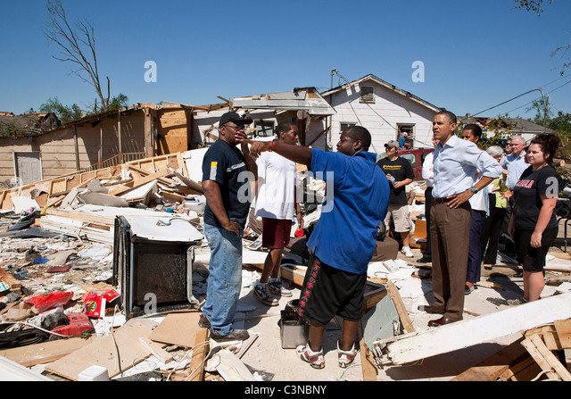 President Barack Obama and First Lady Michelle Obama inspect tornado damage in Tuscaloosa, AL, USA. - Stock Image