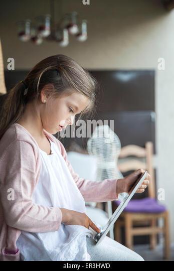 Little girl using digital tablet - Stock-Bilder
