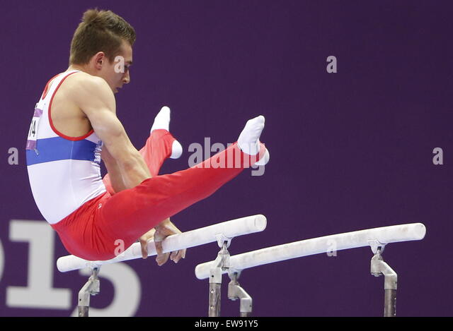 Baku, Azerbaijan. 20th June, 2015. David Belyavskiy of Russia performs on the parallel bars during the Artistic - Stock-Bilder